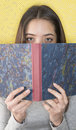 Attractive young woman reading a diary Royalty Free Stock Image
