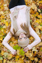 Attractive young woman relaxing in atumn park outdoor nature yellow Stock Photos