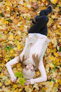 Attractive young woman relaxing in atumn park outdoor nature yellow Royalty Free Stock Photo