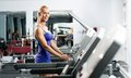 Attractive young woman runs on a treadmill Stock Photo