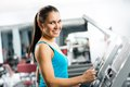 Attractive young woman runs on a treadmill is engaged in fitness sport club Royalty Free Stock Images