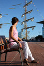 Attractive young woman in a sea port Stock Photos