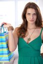 Attractive young woman with shopping bags holding looking at camera Stock Images