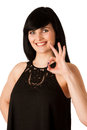 Attractive young woman showing ok sign with thumb up isolated Royalty Free Stock Photography