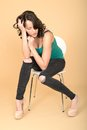 Attractive young woman sitting on a chair in high heel shoes dslr royalty free image of an with dark brown hair white looking Royalty Free Stock Photo