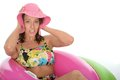 Attractive Young Woman Sitting in Rubber Ring Wearing a Swimsuit