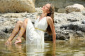 Attractive young woman sitting in the water Royalty Free Stock Images