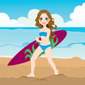 Attractive young woman surfer holding surfboard walking beach Royalty Free Stock Image