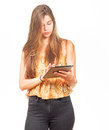 Attractive young woman surfing on a tablet Royalty Free Stock Photo
