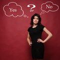 Attractive young woman thinking yes or no Stock Images