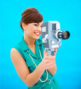Attractive young woman using an antique camera Royalty Free Stock Photo