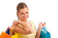 Attractive young woman with vibrant shopping bags isolated over white background Royalty Free Stock Photos