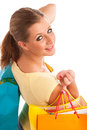 Attractive young woman with vibrant shopping bags isolated over white background Stock Image