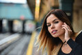 Attractive young woman waiting for a train on the platform of NYC subway. Royalty Free Stock Photo