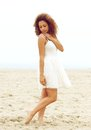 Attractive young woman walking alone on beach Royalty Free Stock Photo