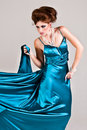 Attractive Young Woman Wearing a Blue Satin Dress Stock Photo