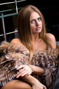 Attractive young woman wearing a fur Stock Photos