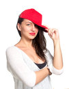 Attractive young woman wearing a red baseball cap isolated Stock Photography