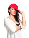 Attractive young woman wearing a red baseball cap isolated Stock Photo