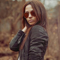 Attractive young woman wearing sunglasses outdoors Royalty Free Stock Image