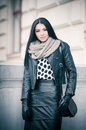 Attractive young woman in a winter fashion shot beautiful fashionable young girl in black leather outfit posing outdoor elegance Royalty Free Stock Images