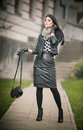 Attractive young woman in a winter fashion shot beautiful fashionable young girl in black leather waking on avenue elegant woman Stock Photography