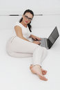 Attractive young woman working on her laptop at home Royalty Free Stock Photo