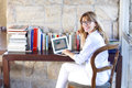 Attrctive woman with laptop at home portrait of smiling beautiful using her while sitting desk Royalty Free Stock Photos