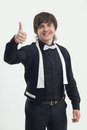 Attributes of good barman half length portrait dark haired handsome smiling wearing nice black costume and white bow tie showing Stock Photo