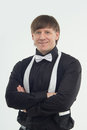 Attributes of good barman half length portrait handsome fair haired smiling wearing elegant black shirt and white bow tie isolated Stock Photography