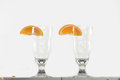 Attributes of good barman two empty glasses cocktails with the slice orange standing on the bar counter Royalty Free Stock Photography