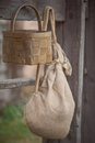 Attributes of village life linen knapsack and wicker basket Royalty Free Stock Image
