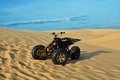 Atv in desert white sand dunes and blue sky Royalty Free Stock Images