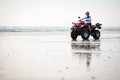 Atv driver on the beach happy ninety mile new zealand Stock Images