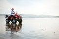 Atv driver on the beach happy ninety mile new zealand Stock Photography