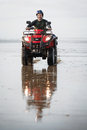 Atv driver on the beach happy ninety mile new zealand Royalty Free Stock Photo