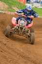 ATV Motocross Rider powering out of corner Stock Photos