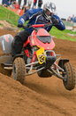 ATV Motocross Rider powering out of corner Royalty Free Stock Image