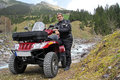 The atv with in mountains Royalty Free Stock Photo