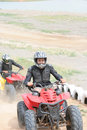 Atv or quad bike vehicle racing Royalty Free Stock Images