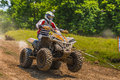 Atv quad racer on vehicle driving in the mud on june in moreni romania Royalty Free Stock Photo