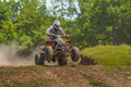Atv racer in the mud on vehicle driving on june moreni romania Royalty Free Stock Images