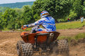 Atv racer takes a turn on vehicle driving in the mud on june in moreni romania Royalty Free Stock Photography