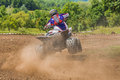 Atv racer takes a turn on vehicle driving in the mud on june in moreni romania Royalty Free Stock Photo