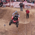 Atv rider on the hill in mid air blazers climb logan iowa april motorcycles and an climb a big Royalty Free Stock Photo