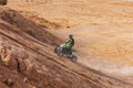 Atv rider uphill in the desert in summer Stock Photos