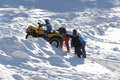 Atv riders in winter a group of people having fun with an at a ski resort romania Stock Images