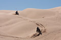 ATVs hopping the dunes Royalty Free Stock Photo