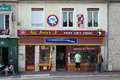 Au jour j normandy france july tourists looks into the window of a souvenir shop for the landings on d day in sainte mere eglise Royalty Free Stock Image