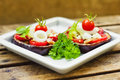 Aubergine towers with mozzarella, tomato and basil Royalty Free Stock Photo